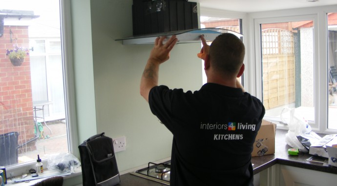 kitchen fitter installing extractor