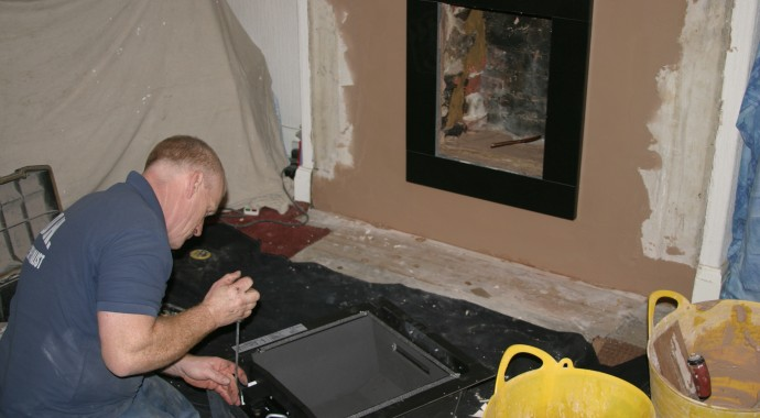 Gas safe fitter fitting hole in the wall gas fire in fireplace showrooms Leeds