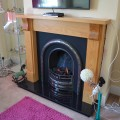 Victorian Arch Cast Iron with Wooden Surround and Granite Hearth Leeds