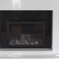 After image of a recently supplied and installed a Marble Fireplace with  black granite slips and a high efficient glass fronted gas fire for Mrs Brown in Halton, Leeds.