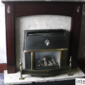 Before image of an installed high efficiency, hole in the wall, glass fronted gas fire