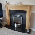 Solid Oak Fireplace with Black Granite back and hearth Leeds