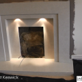 During image of Marble fireplace with glass fronted fire in Fireplace showroom Leeds.