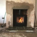 Log burner in Leeds with brickwork