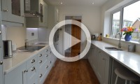 Galley kitchen with breakfast bar - kitchens Leeds