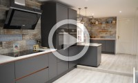 Modern graphite kitchen with copper rails - kitchens Leeds